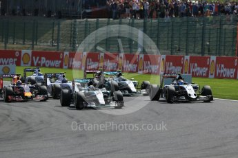 World © Octane Photographic Ltd. Mercedes AMG Petronas F1 W06 Hybrid – Lewis Hamilton and Sahara Force India VJM08B – Sergio Perez side by side into La Source hairpin on lap 1. Sunday 23rd August 2015, F1 Belgian GP Race, Spa-Francorchamps, Belgium. Digital Ref: 1389LB1D2032