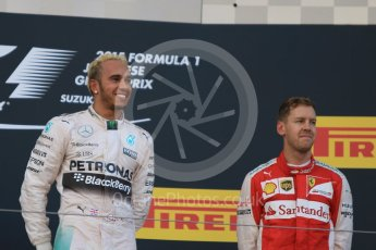 World © Octane Photographic Ltd. Mercedes AMG Petronas F1 W06 Hybrid – Lewis Hamilton (1st) and Scuderia Ferrari SF15-T– Sebastian Vettel (3rd).. Sunday 27th September 2015, F1 Japanese Grand Prix, Podium, Suzuka. Digital Ref: