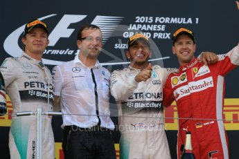 World © Octane Photographic Ltd. Mercedes AMG Petronas F1 W06 Hybrid – Lewis Hamilton (1st), Nico Rosberg (2nd) and Scuderia Ferrari SF15-T– Sebastian Vettel (3rd). Sunday 27th September 2015, F1 Japanese Grand Prix, Podium, Suzuka. Digital Ref: