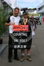 World © Octane Photographic Ltd. McLaren Honda MP4/30 - Jenson Button and fan in the paddock. Saturday 26th September 2015, F1 Japanese Grand Prix, Paddock, Suzuka. Digital Ref: 1445CB5D1835