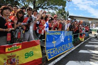 World © Octane Photographic Ltd. The Japanese fans waiting at the paddock entrance. Saturday 26th September 2015, F1 Japanese Grand Prix, Paddock, Suzuka. Digital Ref: 1445CB7D6320