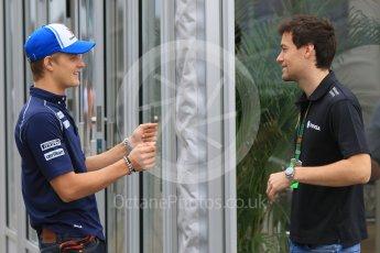 World © Octane Photographic Ltd. Sauber F1 Team C34-Ferrari – Marcus Ericsson and Lotus F1 Team Reserve Driver – Jolyon Palmer discussing Marcus' big slide yesterday. Sunday 27th September 2015, F1 Japanese Grand Prix, Setup, Suzuka. Digital Ref: 1448CB7D7883