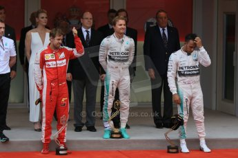 World © Octane Photographic Ltd. Mercedes AMG Petronas F1 W06 Hybrid – Nico Rosberg, Scuderia Ferrari SF15-T– Sebastian Vettel and Lewis Hamilton. Sunday 24th May 2015, F1 Race - Podium, Monte Carlo, Monaco. Digital Ref: 1287CB7D8233