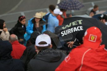 """World © Octane Photographic Ltd. Fans in the grandstand with """"Wet Surface"""" umbrella. Friday 5th June 2015, F1 Practice 2, Circuit Gilles Villeneuve, Montreal, Canada. Digital Ref: 1292LB1D0341"""