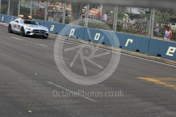 World © Octane Photographic Ltd. Charlie Whiting and Herbie Blash in the Mercedes AMG GTs Safety car. Friday 18th September 2015, F1 Singapore Grand Prix Practice 1, Marina Bay. Digital Ref: 1428CB5D9551