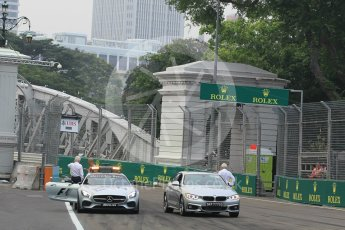 World © Octane Photographic Ltd. Charlie Whiting and Herbie Blash examining the new 12 after the new Anderson bridge layout change. Friday 18th September 2015, F1 Singapore Grand Prix Practice 1, Marina Bay. Digital Ref: 1428LB1L9627