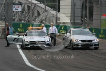 World © Octane Photographic Ltd. Charlie Whiting and Herbie Blash examining the new 12 after the new Anderson bridge layout change. Friday 18th September 2015, F1 Singapore Grand Prix Practice 1, Marina Bay. Digital Ref: 1428LB1L9633