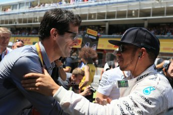 World © Octane Photographic Ltd. Mercedes AMG Petronas F1 W06 Hybrid – Lewis Hamilton and Mark Webber. Sunday 10th May 2015, F1 Spanish GP Formula 1 Grid, Circuit de Barcelona-Catalunya, Spain. Digital Ref: 1264LB1D0256