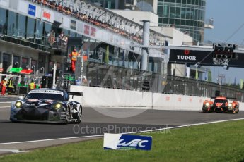 World © Octane Photographic Ltd. FIA World Endurance Championship (WEC), 6 Hours of Nurburgring , Germany - Race, Sunday 30th August 2015. Abu Dhabi-Proton Racing – Porsche 911 RSR - LMGTE Am – Christian Ried, Earl Bamber and Khaled Al Qubaisi and G-Drive Racing – Nissan Ligier JS P2 – LMP2 – Roman Rusinov, Julien Canal and Sam Bird. Digital Ref : 1398LB1D7104