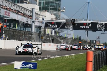 World © Octane Photographic Ltd. FIA World Endurance Championship (WEC), 6 Hours of Nurburgring , Germany - Race, Sunday 30th August 2015. Porsche Team – Porsche 919 Hybrid - LMP1 - Timo Bernhard, Mark Webber and Brendon Hartley ahead of the Audi Sport Team Joest- Audi R18 e-tron Quatrros of Oliver Jarvis, Lucas di Grassi and Loic Duval and Andre Lotterer, Benoit Treluyer and Marcel Fassler. Digital Ref : 1398LB1D7125