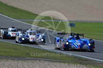 World © Octane Photographic Ltd. FIA World Endurance Championship (WEC), 6 Hours of Nurburgring , Germany - Race, Sunday 30th August 2015. Signatech Alpine – Alpine A450b - LMP2 - Nelson Panciatici, Paul-Loup Chatin and Vincent Capillaire, Toyota Racing – Toyota TS040 Hybrid - LMP1 - Anthony Davidson, Sebastien Buemi and Kazuki Nakajima and Audi Sport Team Joest- Audi R18 e-tron Quatrro - LMP1 - Andre Lotterer, Benoit Treluyer and Marcel Fassler. Digital Ref : 1398LB1D7410