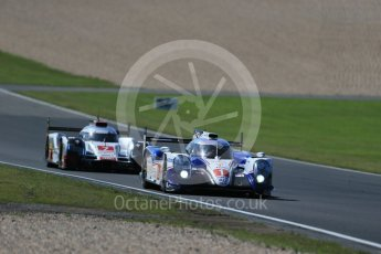 World © Octane Photographic Ltd. FIA World Endurance Championship (WEC), 6 Hours of Nurburgring , Germany - Race, Sunday 30th August 2015. Toyota Racing – Toyota TS040 Hybrid - LMP1 - Anthony Davidson, Sebastien Buemi and Kazuki Nakajima and Audi Sport Team Joest- Audi R18 e-tron Quatrro - LMP1 - Andre Lotterer, Benoit Treluyer and Marcel Fassler. Digital Ref : 1398LB1D7413
