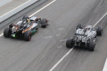 World © Octane Photographic Ltd. Sahara Force India VJM07 – Pascal Wehrlein passes the Infiniti Red Bull Racing RB11 – Daniil Kvyat at the pit exit. Saturday 21st February 2015, F1 Winter testing, Circuit de Barcelona Catalunya, Spain, Day 3. Digital Ref :1190CB1L6988