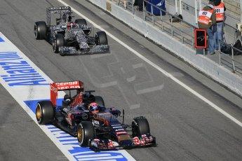 World © Octane Photographic Ltd. Scuderia Toro Rosso STR10 – Max Verstappen and Infiniti Red Bull Racing RB11 – Daniil Kvyat released at the same time into the pitlane. Saturday 21st February 2015, F1 Winter testing, Circuit de Barcelona Catalunya, Spain, Day 3. Digital Ref: 1190CB1L8610