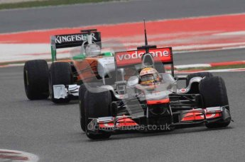 © Octane Photographic 2011. Formula 1 testing Sunday 20th February 2011 Circuit de Catalunya. McLaren MP4/26 - Lewis Hamilton, Force India VJM04 - Adrian Sutil. Digital ref : 0010LW7D3696