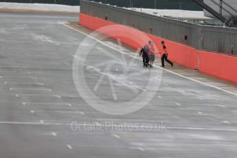 World © Octane Photographic Ltd. Wooden beam being cleared from track after falling from the start line overhead gantry. Tuesday 12th July 2016, F1 In-season testing, Silverstone UK. Digital Ref : 1618LB1D7851