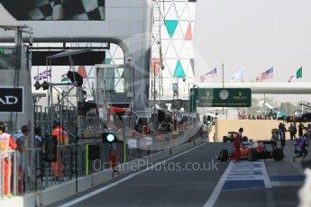 World © Octane Photographic Ltd. Ferrari heading out the pitlane at the start of the session. Friday 25th November 2016, F1 Abu Dhabi GP - Practice 1, Yas Marina circuit, Abu Dhabi. Digital Ref :
