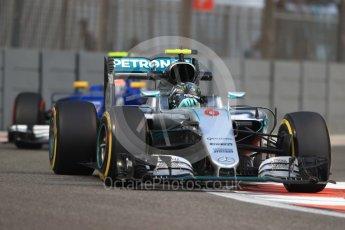 World © Octane Photographic Ltd. Mercedes AMG Petronas W07 Hybrid – Nico Rosberg and Sauber F1 Team C35 – Felipe Nasr. Friday 25th November 2016, F1 Abu Dhabi GP - Practice 2. Yas Marina circuit, Abu Dhabi. Digital Ref :