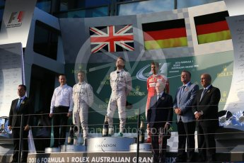 World © Octane Photographic Ltd. Mercedes AMG Petronas – Nico Rosberg, Lewis Hamilton and Scuderia Ferrari – Sebastian Vettel. Sunday 20th March 2016, F1 Australian GP Race - Podium, Melbourne, Albert Park, Australia. Digital Ref : 1525LB1D7771