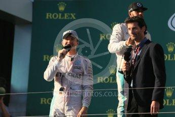 World © Octane Photographic Ltd. Mercedes AMG Petronas – Nico Rosberg and Mark Webber. Sunday 20th March 2016, F1 Australian GP Race - Podium, Melbourne, Albert Park, Australia. Digital Ref : 1525LB1D8150