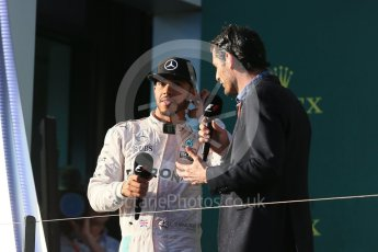 World © Octane Photographic Ltd. Mercedes AMG Petronas – Lewis Hamilton and Mark Webber. Sunday 20th March 2016, F1 Australian GP Race - Podium, Melbourne, Albert Park, Australia. Digital Ref : 1525LB1D8253