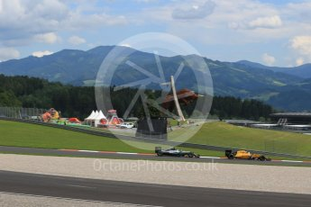World © Octane Photographic Ltd. Renault Sport F1 Team RS16 - Kevin Magnussen and Mercedes AMG Petronas W07 Hybrid – Nico Rosberg. Friday . Friday 1st July 2016, F1 Austrian GP Practice 2, Red Bull Ring, Spielberg, Austria. Digital Ref : 1600LB1D5561