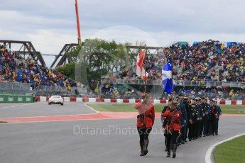 World © Octane Photographic Ltd. RCMP lead the Armed Forces march past. Sunday 12th June 2016, F1 Canadian GP Grid, Circuit Gilles Villeneuve, Montreal, Canada. Digital Ref :1591LB1D3241