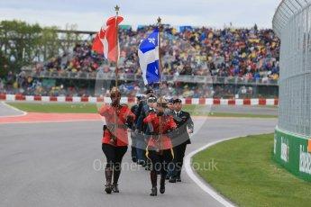 World © Octane Photographic Ltd. RCMP lead the Armed Forces march past. Sunday 12th June 2016, F1 Canadian GP Grid, Circuit Gilles Villeneuve, Montreal, Canada. Digital Ref :1591LB1D3248