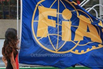 World © Octane Photographic Ltd. Grid girl with FIA flag. Sunday 12th June 2016, F1 Canadian GP Grid, Circuit Gilles Villeneuve, Montreal, Canada. Digital Ref :1591LB1D3253