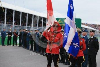 World © Octane Photographic Ltd. RCMP lead the Armed Forces march past. Sunday 12th June 2016, F1 Canadian GP Grid, Circuit Gilles Villeneuve, Montreal, Canada. Digital Ref :1591LB1D3352