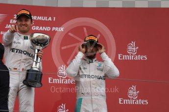 World © Octane Photographic Ltd. Mercedes AMG Petronas – Nico Rosberg (1st) and Lewis Hamilton (3rd). Sunday 9th October 2016, F1 Japanese GP - Podium. Suzuka Circuit, Suzuka, Japan. Digital Ref :1737LB1D8489