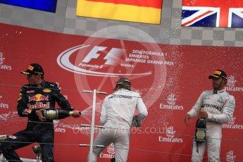 World © Octane Photographic Ltd. Mercedes AMG Petronas – Nico Rosberg (1st), Red Bull Racing – Max Verstappen (2nd) and Mercedes AMG Petronas – Lewis Hamilton (3rd). Sunday 9th October 2016, F1 Japanese GP - Podium. Suzuka Circuit, Suzuka, Japan. Digital Ref :1737LB1D8585