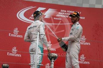 World © Octane Photographic Ltd. Mercedes AMG Petronas – Nico Rosberg (1st) and Lewis Hamilton (3rd). Sunday 9th October 2016, F1 Japanese GP - Podium. Suzuka Circuit, Suzuka, Japan. Digital Ref :1737LB1D8642