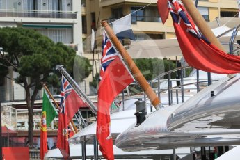 World © Octane Photographic Ltd. Flags on the yachts in the harbour. Wednesday 25th May 2016, F1 Monaco GP Paddock, Monaco, Monte Carlo. Digital Ref :1559CB7D9981