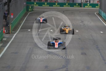 World © Octane Photographic Ltd. Manor Racing MRT05 - Pascal Wehrlein and Esteban Ocon split by Renault Sport F1 Team RS16 – Jolyon Palmer. Friday 16th September 2016, F1 Singapore GP Practice 1, Marina Bay Circuit, Singapore. Digital Ref :