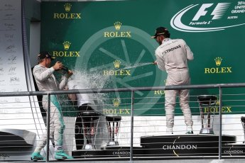 World © Octane Photographic Ltd. Mercedes AMG Petronas – Lewis Hamilton (1st) and Nico Rosberg (2nd) with Victoria Vowels - Mercedes Partner Services Director. Sunday 23rd October 2016, F1 USA Grand Prix Podium, Austin, Texas – Circuit of the Americas (COTA). Digital Ref :1750LB1D4437