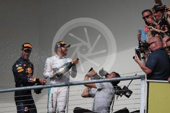 World © Octane Photographic Ltd. Fans with Mercedes AMG Petronas – Lewis Hamilton (1st) and Red Bull Racing – Daniel Ricciardo (3rd). Sunday 23rd October 2016, F1 USA Grand Prix Podium, Austin, Texas – Circuit of the Americas (COTA). Digital Ref :1750LB1D4481
