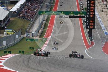 World © Octane Photographic Ltd. McLaren Honda MP4-31 – Jenson Button and Haas F1 Team VF-16 - Esteban Gutierrez. Sunday 23rd October 2016, F1 USA Grand Prix Race, Austin, Texas – Circuit of the Americas (COTA). Digital Ref :1749LB1D3714