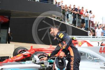 World © Octane Photographic Ltd. Formula 1 - British Grand Prix - Sunday - Race. Daniel Ricciardo - Red Bull Racing pretends to steal Lewis Hamiltons Mercedes AMG Petronas F1 W08 EQ Energy+. Silverstone, UK. Sunday 16th July 2017. Digital Ref: 1893LB1D4589