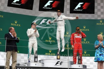 World © Octane Photographic Ltd. Formula 1 - British Grand Prix - Sunday - Race Podium. Lewis Hamilton and Valtteri Bottas - Mercedes AMG Petronas F1 W08 EQ Energy+ and Kimi Raikkonen - Scuderia Ferrari SF70H. Silverstone, UK. Sunday 16th July 2017. Digital Ref: 1893LB1D4676