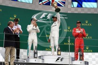World © Octane Photographic Ltd. Formula 1 - British Grand Prix - Sunday - Race Podium. Lewis Hamilton and Valtteri Bottas - Mercedes AMG Petronas F1 W08 EQ Energy+ and Kimi Raikkonen - Scuderia Ferrari SF70H. Silverstone, UK. Sunday 16th July 2017. Digital Ref: 1893LB1D4863