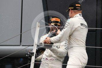 World © Octane Photographic Ltd. Formula 1 - British Grand Prix - Sunday - Race Podium. Lewis Hamilton and Valtteri Bottas - Mercedes AMG Petronas F1 W08 EQ Energy+ and Kimi Raikkonen - Scuderia Ferrari SF70H. Silverstone, UK. Sunday 16th July 2017. Digital Ref: 1893LB1D5053