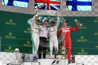 World © Octane Photographic Ltd. Formula 1 - British Grand Prix - Sunday - Race Podium. Lewis Hamilton and Valtteri Bottas - Mercedes AMG Petronas F1 W08 EQ Energy+ and Kimi Raikkonen - Scuderia Ferrari SF70H. Silverstone, UK. Sunday 16th July 2017. Digital Ref: 1893LB1D5131