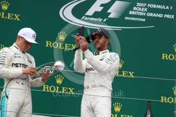 World © Octane Photographic Ltd. Formula 1 - British Grand Prix - Sunday - Race Podium. Lewis Hamilton and Valtteri Bottas Mercedes AMG Petronas F1 W08 EQ Energy+. Silverstone, UK. Sunday 16th July 2017. Digital Ref: 1893LB1D5319