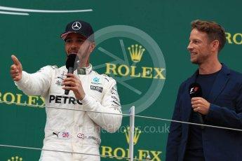World © Octane Photographic Ltd. Formula 1 - British Grand Prix - Sunday - Race Podium. Lewis Hamilton - Mercedes AMG Petronas F1 W08 EQ Energy+ and Jenson Button. Silverstone, UK. Sunday 16th July 2017. Digital Ref: 1893LB1D5381