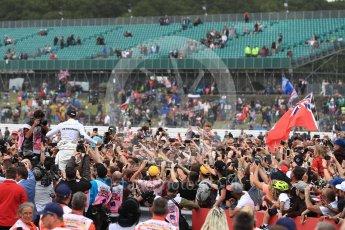 World © Octane Photographic Ltd. Formula 1 - British Grand Prix - Sunday - Race Podium. Lewis Hamilton - Mercedes AMG Petronas F1 W08 EQ Energy+ crowd surfs. Silverstone, UK. Sunday 16th July 2017. Digital Ref: 1893LB1D5540