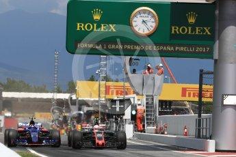 World © Octane Photographic Ltd. Formula 1 - Spanish Grand Prix Race. Carlos Sainz - Scuderia Toro Rosso STR12 and Kevin Magnussen - Haas F1 Team VF-17 go wheel to wheel out of the pits. Circuit de Barcelona - Catalunya, Spain. Sunday 14th May 2017. Digital Ref:1825LB1D4343