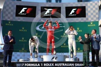 World © Octane Photographic Ltd. Formula 1 - Australian Grand Prix - Podium. Sebastian Vettel - Scuderia Ferrari SF70H, Lewis Hamilton and Valtteri Bottas - Mercedes AMG Petronas F1 W08 EQ Energy+. Albert Park Circuit. Sunday 26th March 2017. Digital Ref: 1803LB1D7332