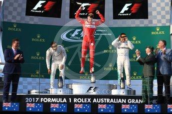 World © Octane Photographic Ltd. Formula 1 - Australian Grand Prix - Podium. Sebastian Vettel - Scuderia Ferrari SF70H, Lewis Hamilton and Valtteri Bottas - Mercedes AMG Petronas F1 W08 EQ Energy+. Albert Park Circuit. Sunday 26th March 2017. Digital Ref: 1803LB1D7335