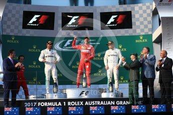 World © Octane Photographic Ltd. Formula 1 - Australian Grand Prix - Podium. Sebastian Vettel - Scuderia Ferrari SF70H, Lewis Hamilton and Valtteri Bottas - Mercedes AMG Petronas F1 W08 EQ Energy+. Albert Park Circuit. Sunday 26th March 2017. Digital Ref: 1803LB1D7344